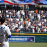 Mar 31, 2014; Detroit, MI, USA; Kansas City Royals first baseman Eric Hosmer (35) during the singing of God Bless America in seventh inning stretch of an opening day baseball game against the Detroit Tigers at Comerica Park. Detroit won 4-3. Mandatory Credit: Rick Osentoski-USA TODAY Sports