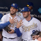 Mike Moustakas and Eric Hosmer show off their World Series rings