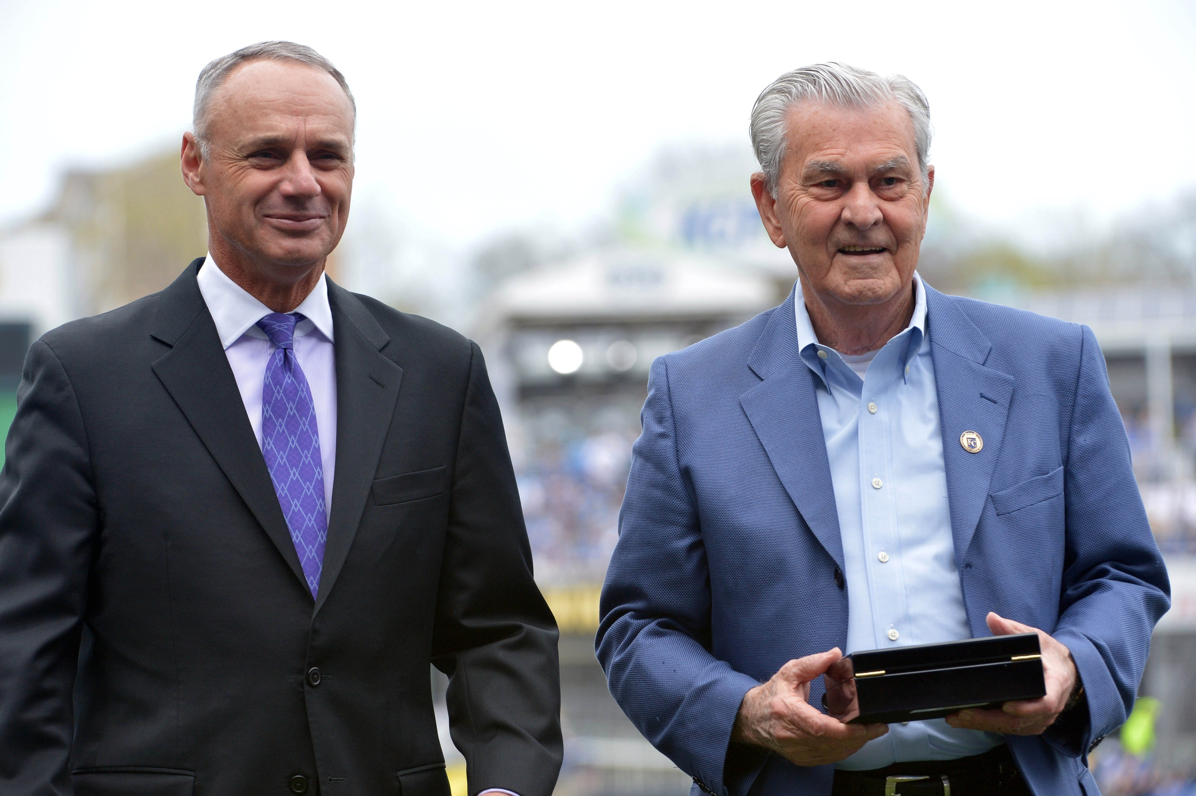 Apr 5, 2016; Kansas City, MO, USA; Major League Baseball commissioner Rob Manfred presents Kansas City Royals owner David Glass (right) his championship ring before the game against the New York Mets at Kauffman Stadium. Mandatory Credit: Denny Medley-USA TODAY Sports