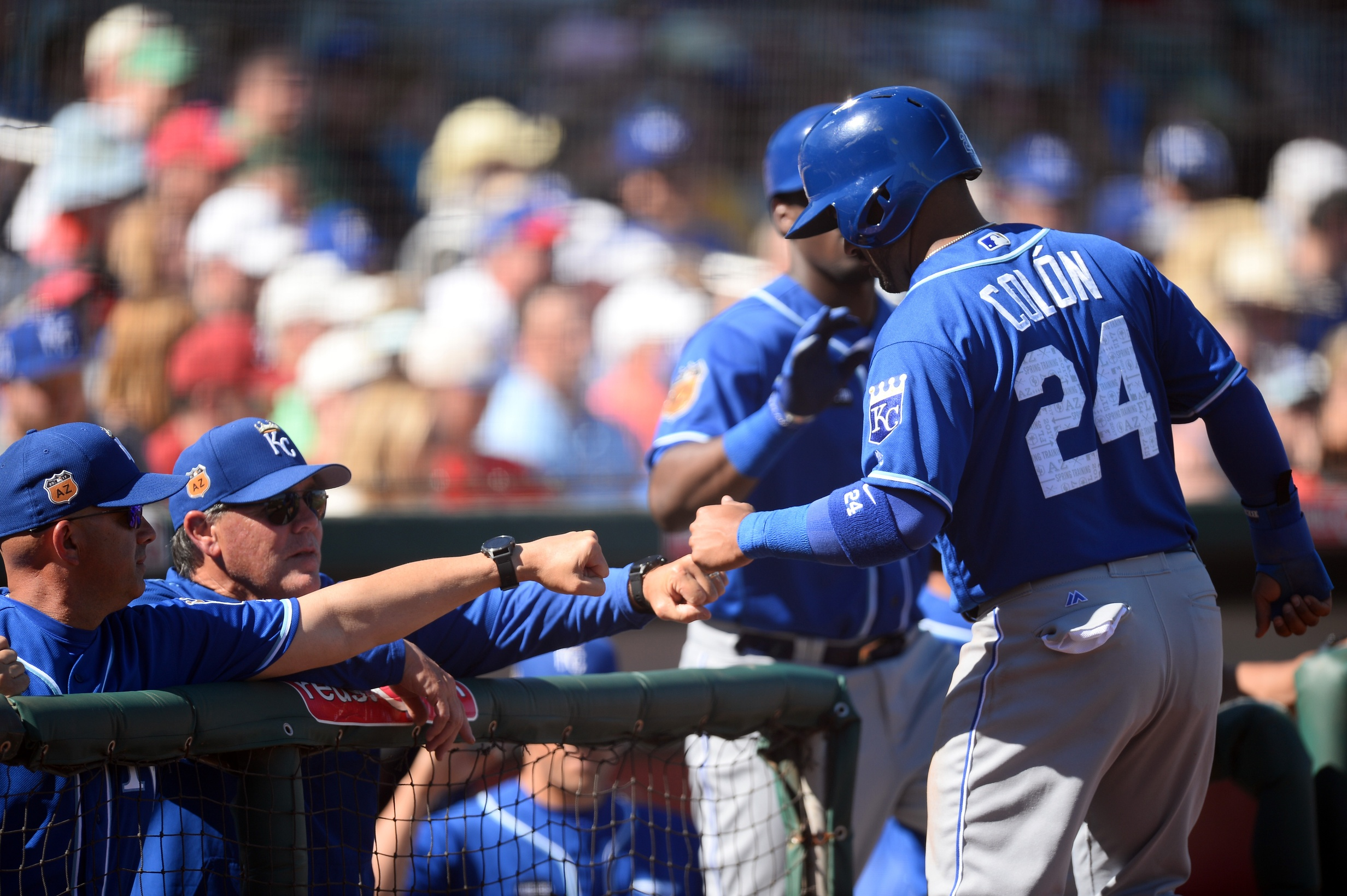 Mar 11, 2017; Goodyear, AZ, USA; Kansas City Royals second baseman Christian Colon (24) fist pounds Kansas City Royals manager Ned Yost (3) after scoring a run against the Cleveland Indians during the fifth inning at Goodyear Ballpark. Mandatory Credit: Joe Camporeale-USA TODAY Sports