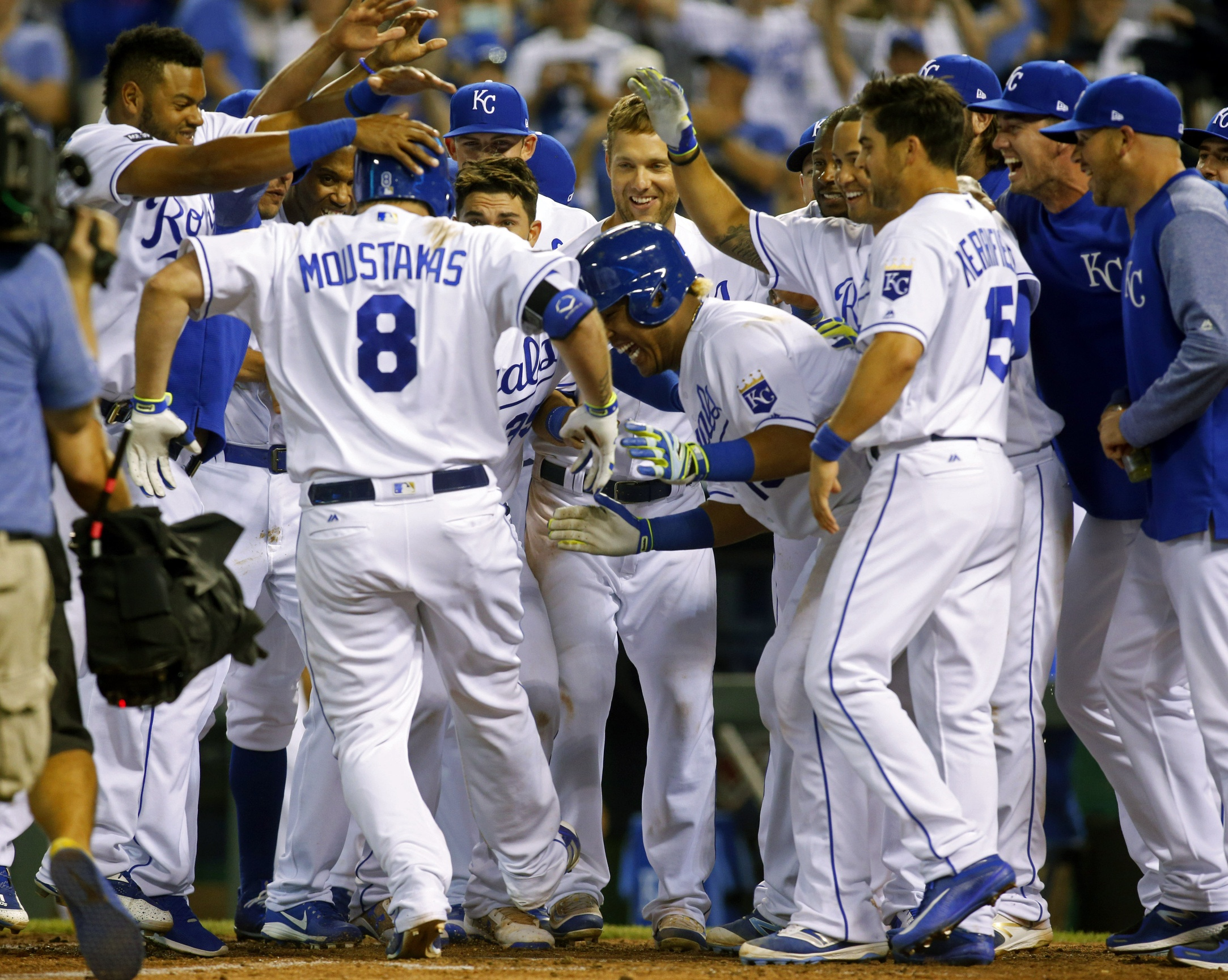 Jun 6, 2017; Kansas City, MO, USA; Kansas City Royals players congratulate designated hitter Mike Moustakas (8) at home plate after hitting a walk-off home run against the Houston Astros in the ninth inning at Kauffman Stadium. The Royals won 9-7. Mandatory Credit: Jay Biggerstaff-USA TODAY Sports