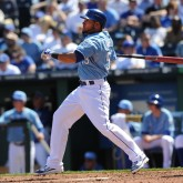 Apr 2, 2011; Kansas City, MO, USA; Kansas City Royals center Melky Cabrera (53) hits the ball to center field during a game against the Los Angeles Angels at Kauffman Stadium. Mandatory Credit: Peter G. Aiken-USA TODAY Sports