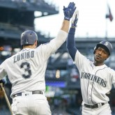 Jul 8, 2017; Seattle, WA, USA; Seattle Mariners center fielder Jarrod Dyson (1) high fives catcher Mike Zunino (3) after hitting a solo home run against the Oakland Athletics during the fifth inning at Safeco Field. Mandatory Credit: Joe Nicholson-USA TODAY Sports