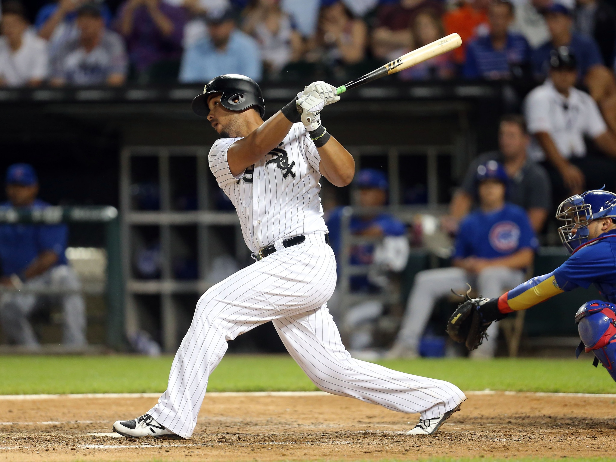 Jul 27, 2017; Chicago, IL, USA; Chicago White Sox first baseman Jose Abreu (79) hits a solo home run during the ninth inning against the Chicago Cubs at Guaranteed Rate Field. Mandatory Credit: Dennis Wierzbicki-USA TODAY Sports