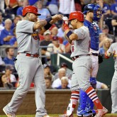 Aug 7, 2017; Kansas City, MO, USA; St. Louis Cardinals second baseman Kolten Wong (16) is congratulated by catcher Yadier Molina (4) after hitting a two run home run in the eighth inning against the Kansas City Royals at Kauffman Stadium. Mandatory Credit: Denny Medley-USA TODAY Sports