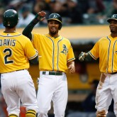 Aug 8, 2017; Oakland, CA, USA; Oakland Athletics left fielder Khris Davis (2) is greeted by shortstop Marcus Semien (10) and center fielder Rajai Davis (11) after hitting a home run against the Seattle Mariners during the first inning at Oakland Coliseum. Mandatory Credit: Stan Szeto-USA TODAY Sports