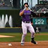 Aug 15, 2017; Denver, CO, USA; Colorado Rockies third baseman Nolan Arenado (28) is celebrates his solo home run in the first inning against the Atlanta Braves at Coors Field. Mandatory Credit: Ron Chenoy-USA TODAY Sports
