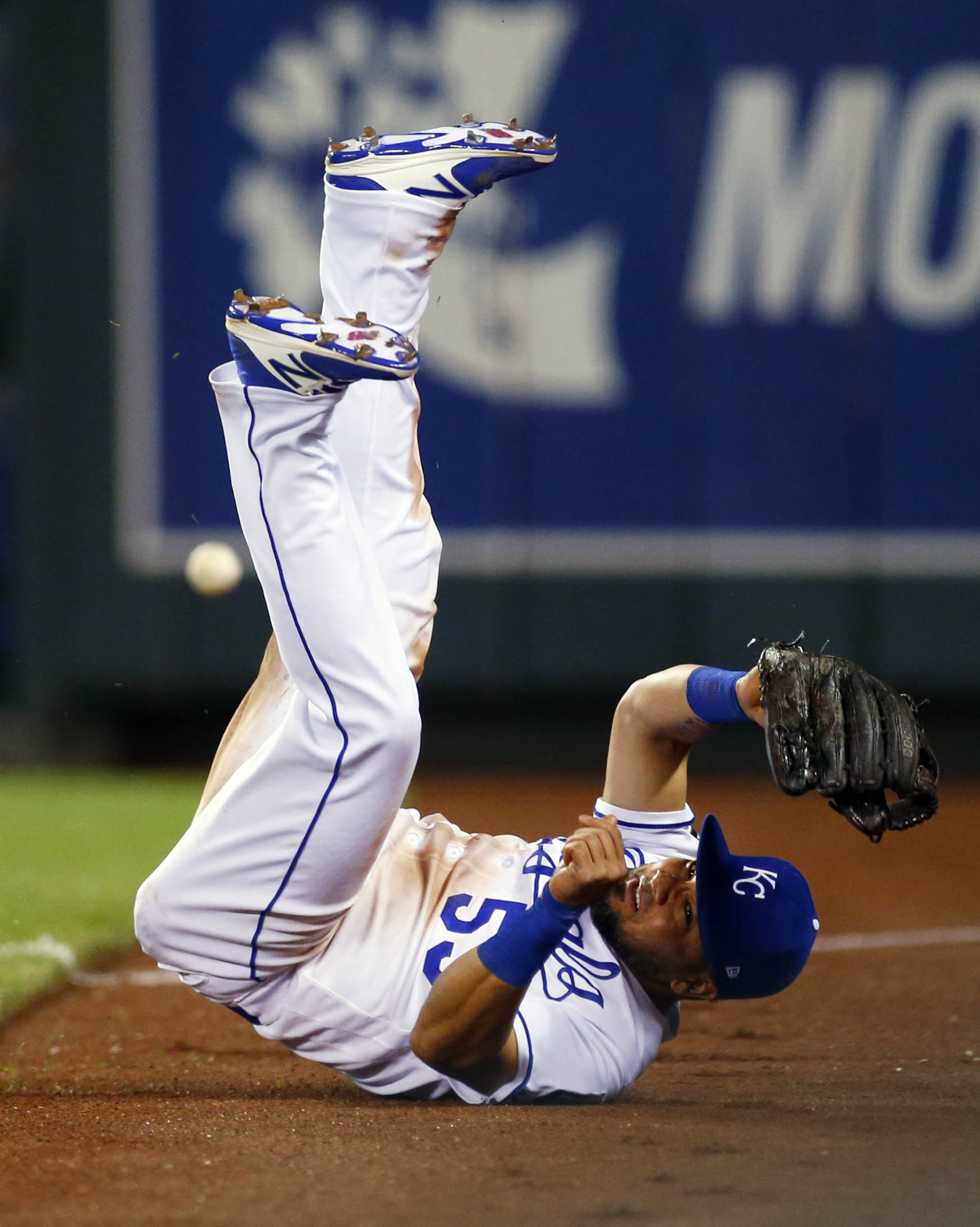 Aug 22, 2017; Kansas City, MO, USA; Kansas City Royals right fielder Melky Cabrera (53) makes a diving attempt at a base hit in the ninth inning of the game against the Colorado Rockies at Kauffman Stadium. Mandatory Credit: Jay Biggerstaff-USA TODAY Sports