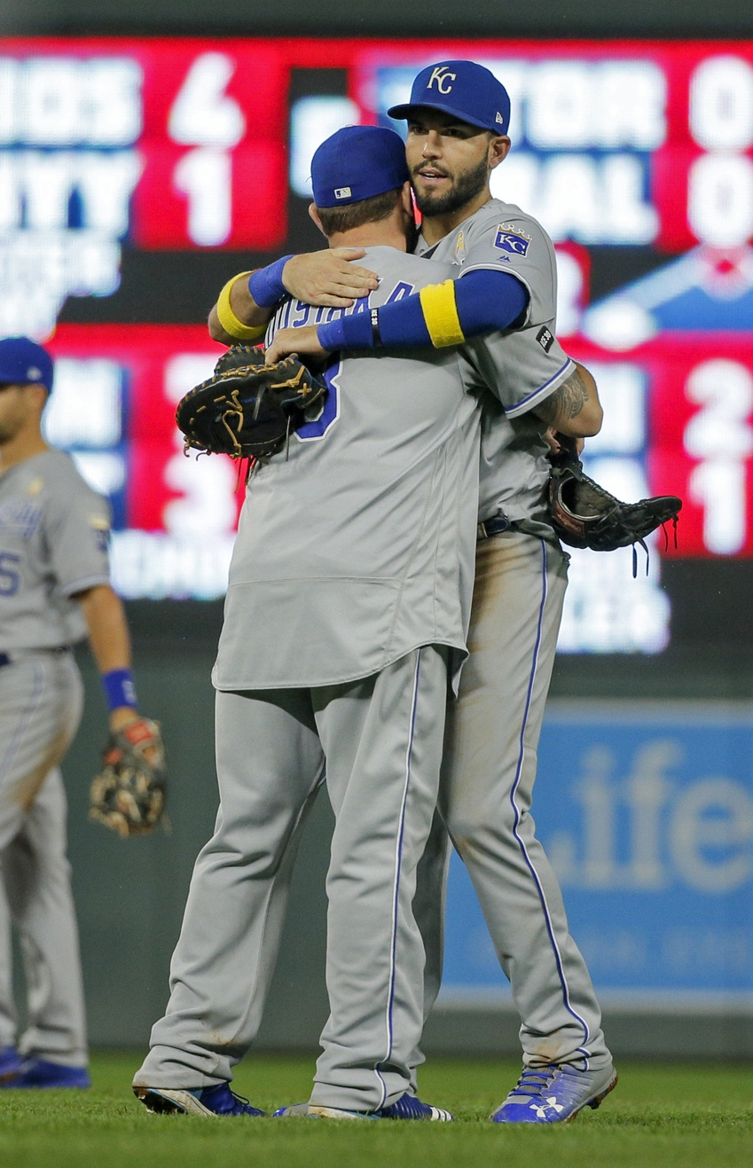 Sep 1, 2017; Minneapolis, MN, USA; Kansas City Royals third baseman Mike Moustakas (8) and first baseman Eric Hosmer (35) celebrate their win over the Minnesota Twins at Target Field. Mandatory Credit: Bruce Kluckhohn-USA TODAY Sports