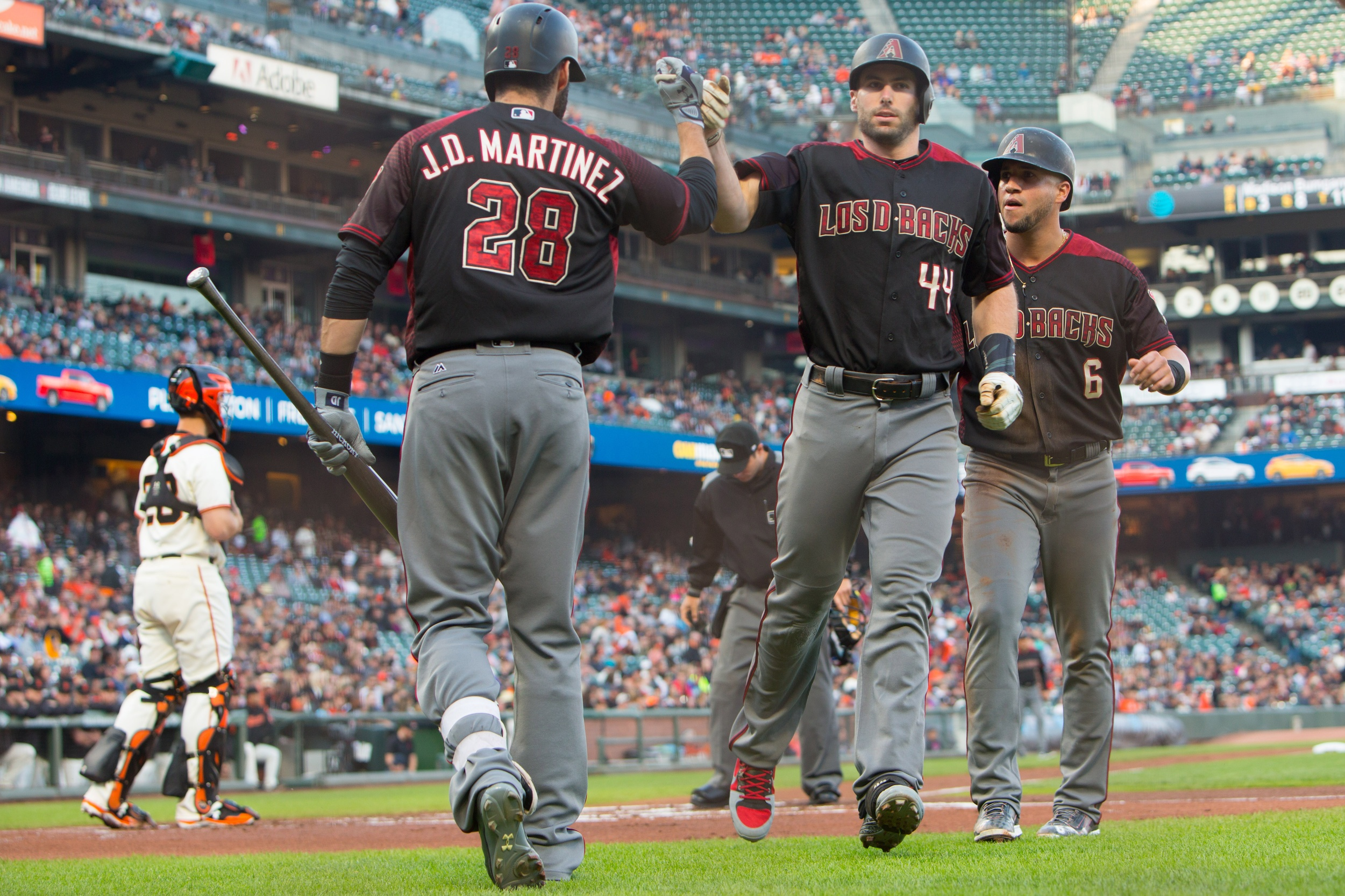 Sep 16, 2017; San Francisco, CA, USA; Arizona Diamondbacks first baseman Paul Goldschmidt (44) high fives right fielder J.D. Martinez (28) and left fielder David Peralta (6) after hitting a two run home run in the first inning against the San Francisco Giants at AT&T Park. Mandatory Credit: Andrew Villa-USA TODAY Sports