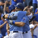 Oct 1, 2017; Kansas City, MO, USA; Kansas City Royals first basemen Eric Hosmer (35) hugs teammate Mike Moustakas (8) after hitting a solo home run against the Arizona Diamondbacks during the first inning at Kauffman Stadium. Mandatory Credit: Peter G. Aiken-USA TODAY Sports