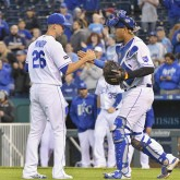 Sep 26, 2017; Kansas City, MO, USA; Kansas City Royals relief pitcher Mike Minor (26) is congratulated by catcher Salvador Perez (13) after a win over the Detroit Tigers at Kauffman Stadium. Mandatory Credit: Denny Medley-USA TODAY Sports