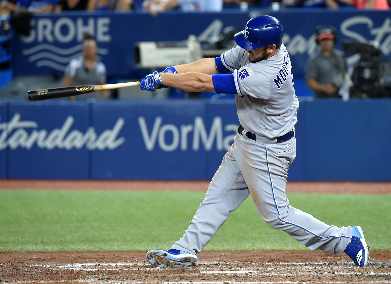 Sep 20, 2017; Toronto, Ontario, CAN; Kansas City Royals third baseman Mike Moustakas (8) hits a home run against the Toronto Blue Jays in the sixth inning at Rogers Centre. Mandatory Credit: Dan Hamilton-USA TODAY Sports