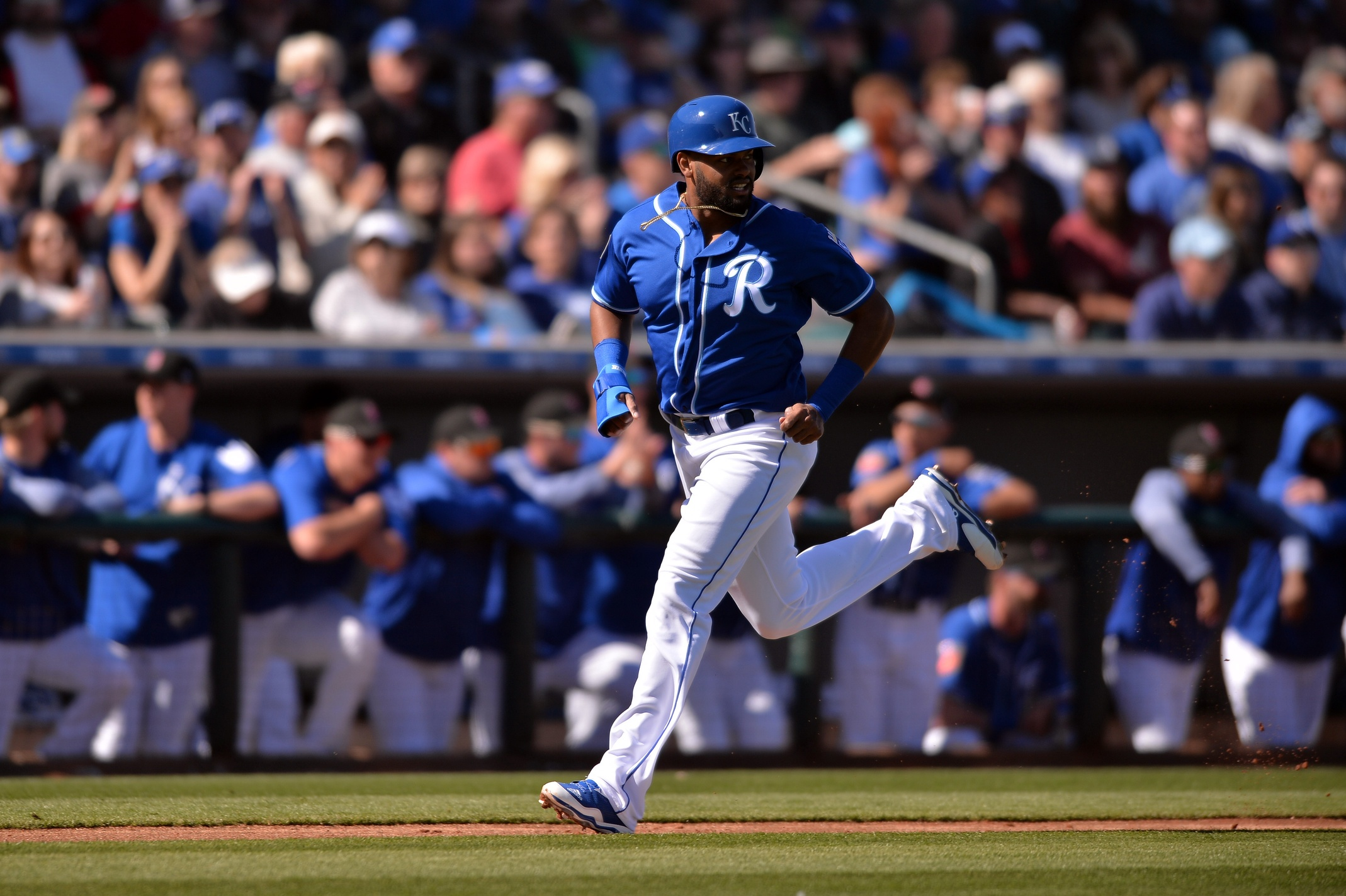 Feb 24, 2018; Surprise, AZ, USA; Kansas City Royals outfielder Jorge Bonifacio (38) heads home on a sacrifice fly by first baseman Hunter Dozier (17) during the second inning against the Los Angeles Dodgers at Surprise Stadium. Mandatory Credit: Orlando Ramirez-USA TODAY Sports