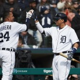 Mar 30, 2018; Detroit, MI, USA; Detroit Tigers first baseman Miguel Cabrera (24) receives congratulations from designated hitter Victor Martinez (41) after scoring in the seventh inning against the Pittsburgh Pirates at Comerica Park. Mandatory Credit: Rick Osentoski-USA TODAY Sports