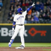 Apr 1, 2018; Seattle, WA, USA; Seattle Mariners second baseman Robinson Cano (22) reacts after hitting a double against the Cleveland Indians during the first inning at Safeco Field. Mandatory Credit: Joe Nicholson-USA TODAY Sports