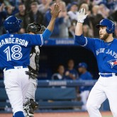 Apr 2, 2018; Toronto, Ontario, CAN; Toronto Blue Jays catcher Russell Martin (55) celebrates hitting a two run home with left fielder Curtis Granderson (18) in the seventh inning against the Chicago White Sox at Rogers Centre. Mandatory Credit: Nick Turchiaro-USA TODAY Sports