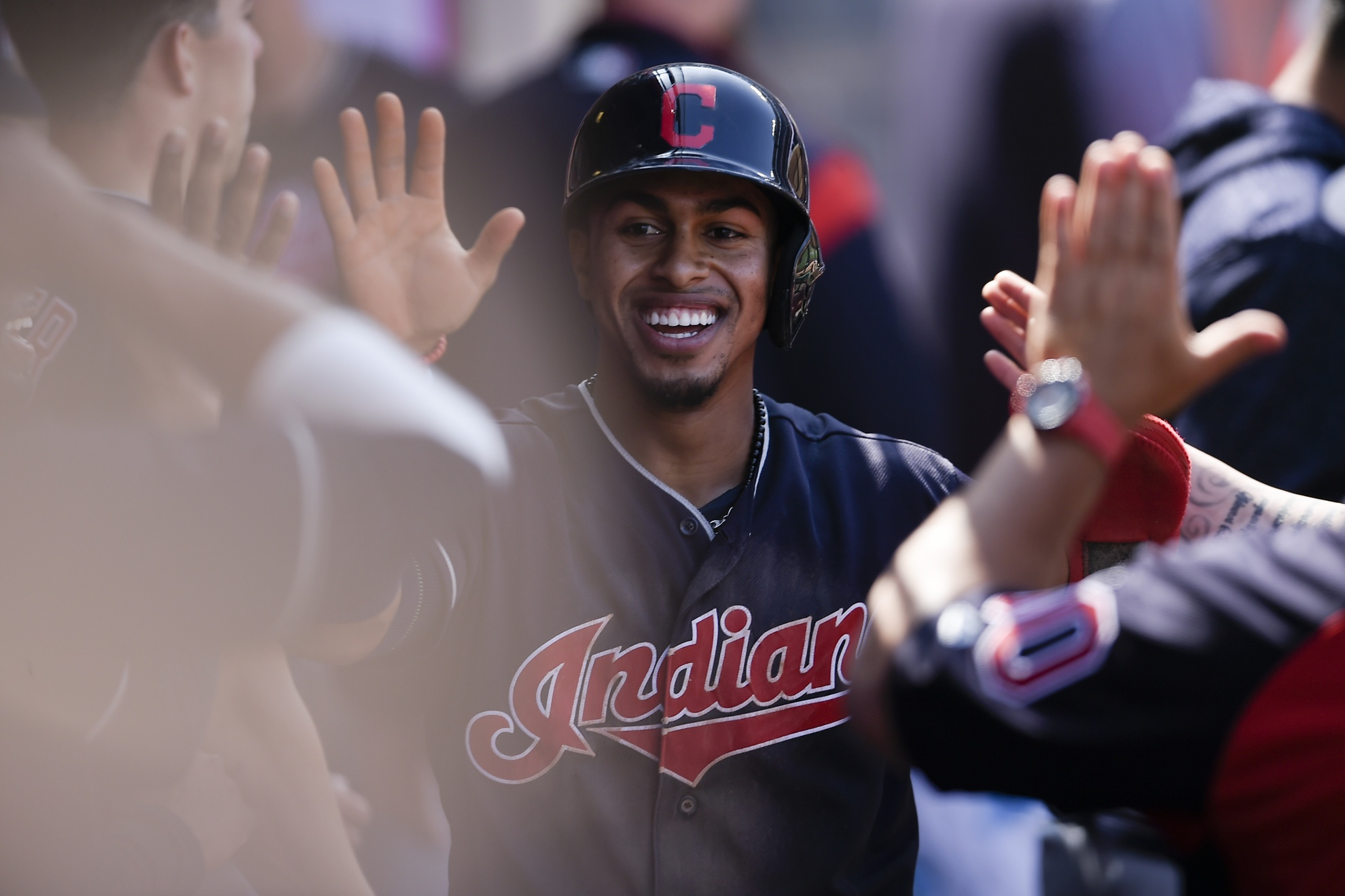 Apr 4, 2018; Anaheim, CA, USA; Cleveland Indians shortstop Francisco Lindor (12) celebrates with the dugout after scoring off an RBI single by second baseman Jason Kipnis (not pictured) during the fifth inning against the Los Angeles Angels at Angel Stadium of Anaheim. Mandatory Credit: Kelvin Kuo-USA TODAY Sports