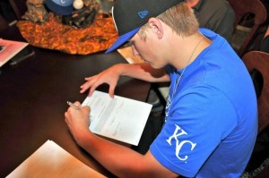 Bryan signing his first contract with Kansas City