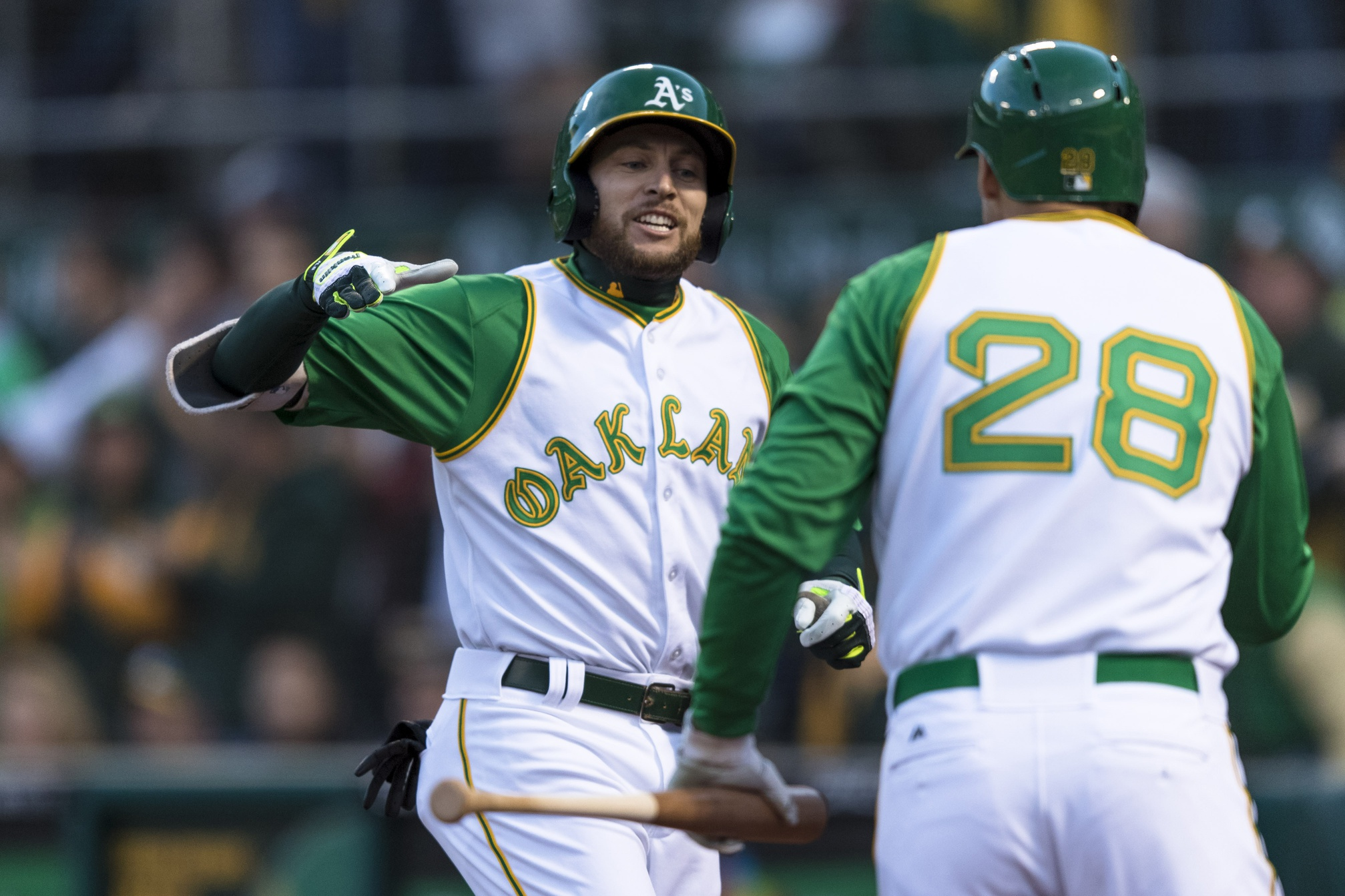 Apr 17, 2018; Oakland, CA, USA; Oakland Athletics second baseman Jed Lowrie (8) celebrates with first baseman Matt Olson (28) after hitting a solo home run against the Chicago White Sox in the first inning at Oakland Coliseum. Mandatory Credit: John Hefti-USA TODAY Sports