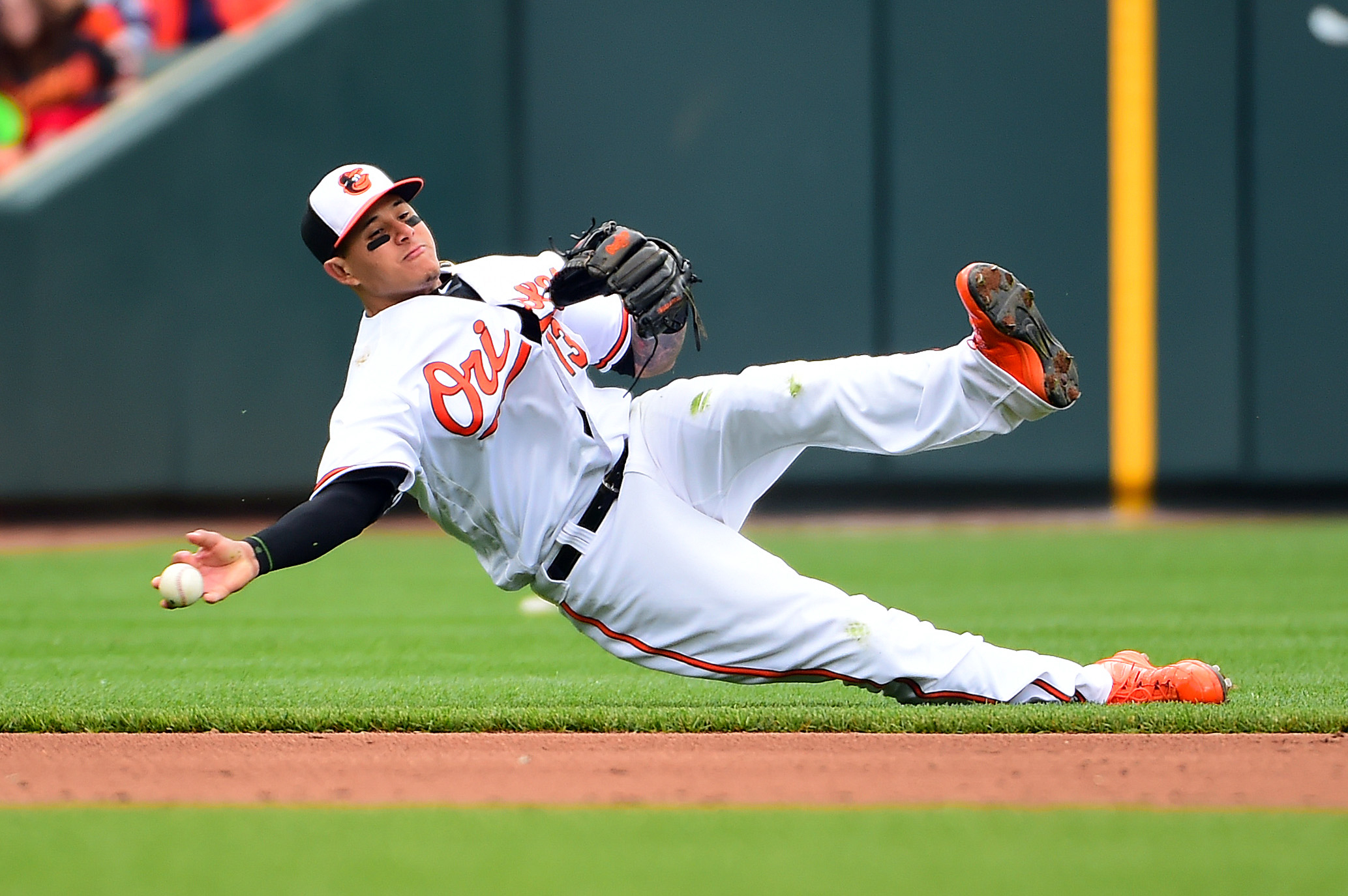 Apr 29, 2018; Baltimore, MD, USA; Baltimore Orioles shortstop Manny Machado (13) fields a ground ball in the sixth inning against the Detroit Tigers at Oriole Park at Camden Yards. Mandatory Credit: Evan Habeeb-USA TODAY Sports