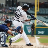 May 2, 2018; Detroit, MI, USA; Detroit Tigers third baseman Jeimer Candelario (46) hits a double in the first inning against the Tampa Bay Rays at Comerica Park. Mandatory Credit: Rick Osentoski-USA TODAY Sports