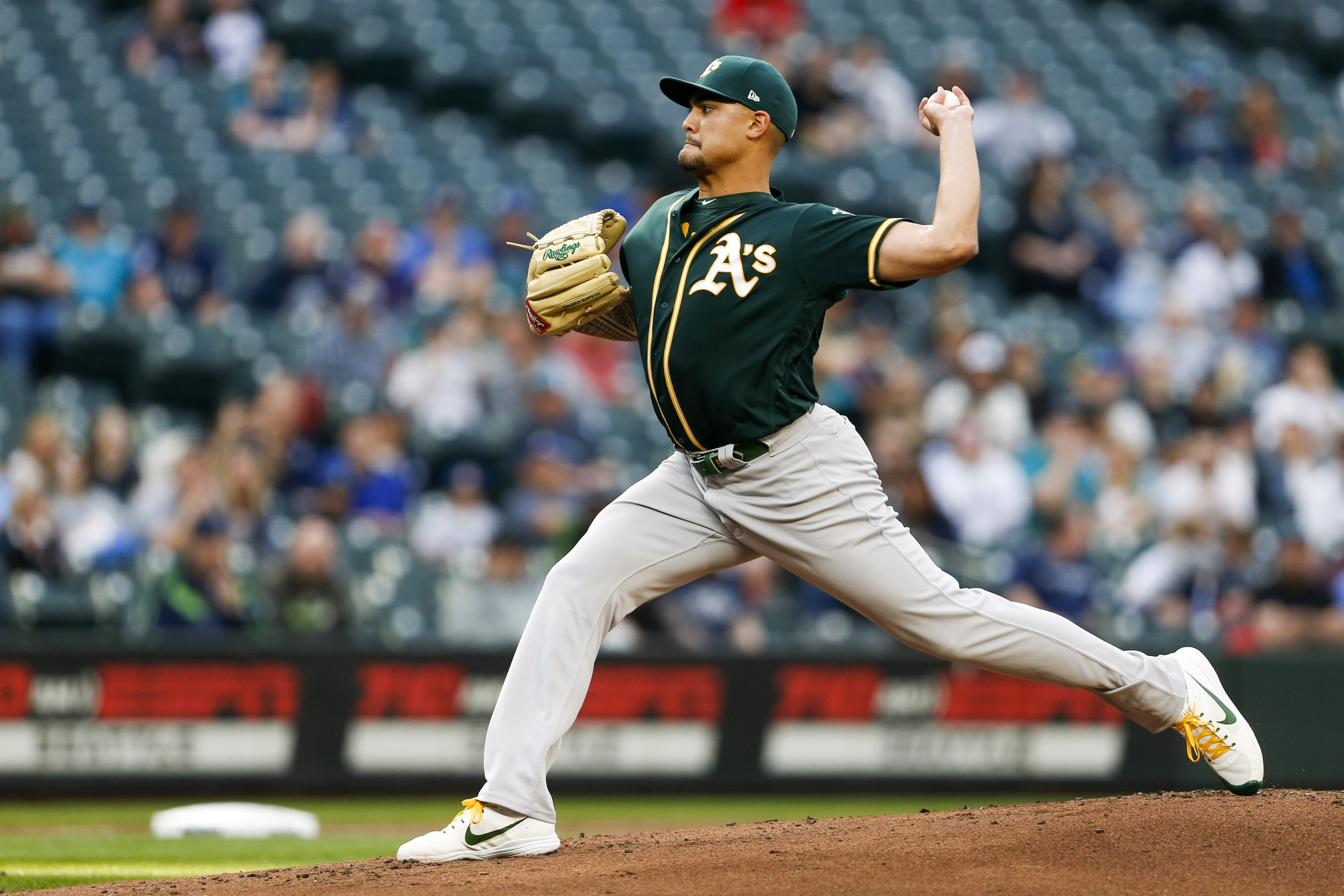 May 3, 2018; Seattle, WA, USA; Oakland Athletics starting pitcher Sean Manaea (55) throws against the Seattle Mariners during the first inning at Safeco Field. Mandatory Credit: Joe Nicholson-USA TODAY Sports