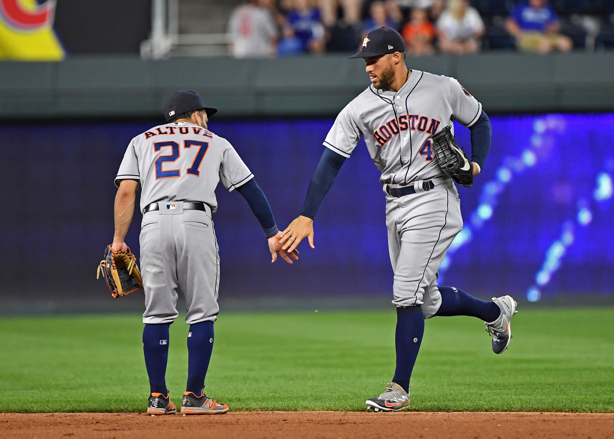 Jun 15, 2018; Kansas City, MO, USA; Houston Astros center fielder George Springer (4) celebrates with Jose Altuve (27) after beating the Kansas City Royals at Kauffman Stadium. Mandatory Credit: Peter G. Aiken/USA TODAY Sports