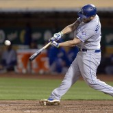 Jun 8, 2018; Oakland, CA, USA; Kansas City Royals third baseman Mike Moustakas (8) has a two run home run during the eighth inning against the Oakland Athletics at Oakland Coliseum. Mandatory Credit: Neville E. Guard-USA TODAY Sports