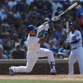 Aug 4, 2018; Chicago, IL, USA; Chicago Cubs third baseman Javier Baez (9) hits a single during the seventh inning against the San Diego Padres at Wrigley Field. Mandatory Credit: Dennis Wierzbicki-USA TODAY Sports