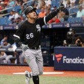 Aug 5, 2018; St. Petersburg, FL, USA; Chicago White Sox right fielder Avisail Garcia (26) points to celebrate as he hits a home run during the seventh inning against the Tampa Bay Rays at Tropicana Field. Mandatory Credit: Kim Klement-USA TODAY Sports