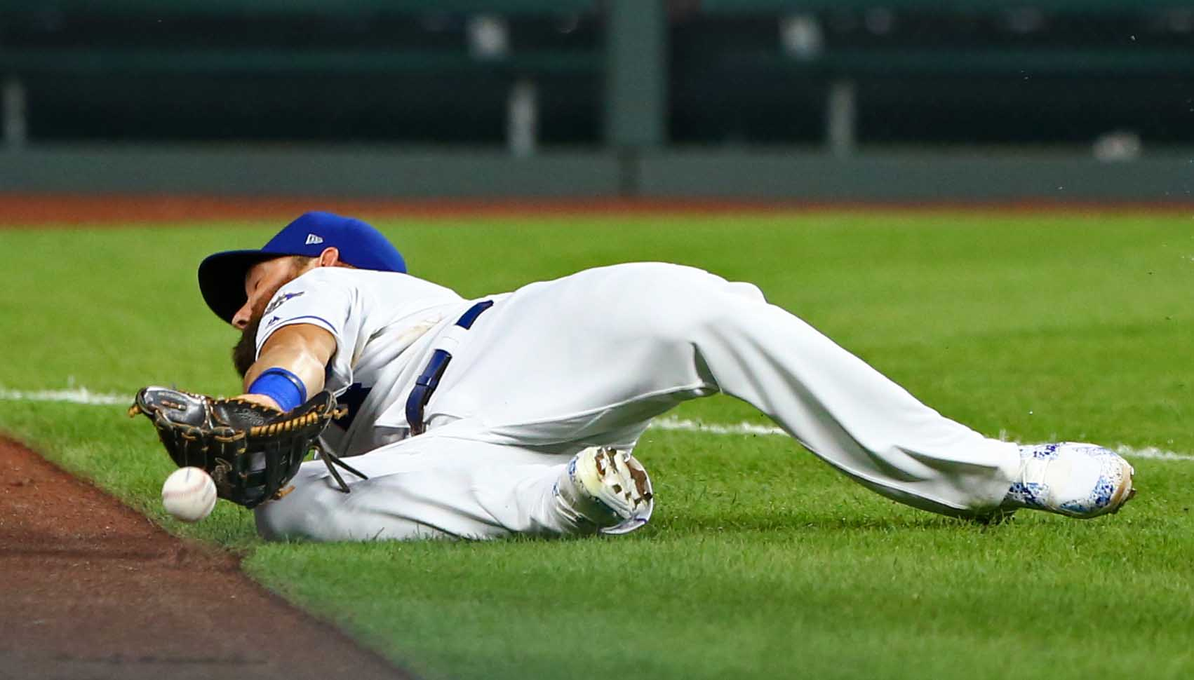Aug 8, 2018; Kansas City, MO, USA; Kansas City Royals left fielder Alex Gordon (4) is unable to make the catch in the fifth inning against the Chicago Cubs at Kauffman Stadium. Mandatory Credit: Jay Biggerstaff-USA TODAY Sports