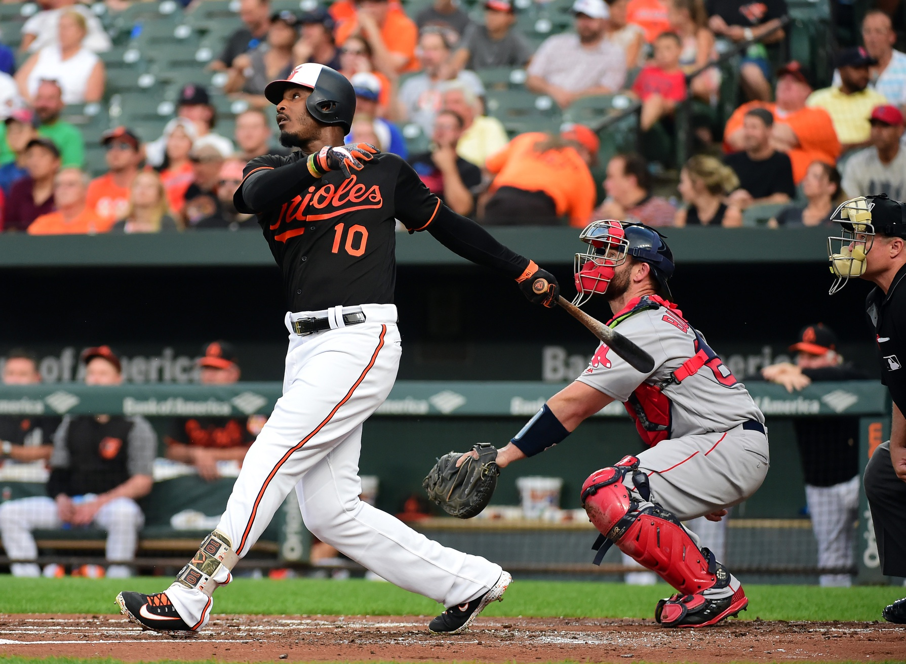 Aug 10, 2018; Baltimore, MD, USA; Baltimore Orioles outfielder Adam Jones (10) singles in the first inning against the Boston Red Sox at Oriole Park at Camden Yards. Mandatory Credit: Evan Habeeb-USA TODAY Sports
