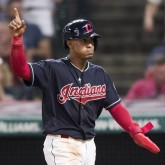 Aug 28, 2018; Cleveland, OH, USA; Cleveland Indians shortstop Francisco Lindor (12) reacts after scoring on a double by third baseman Jose Ramirez during the sixth inning against the Minnesota Twins at Progressive Field. Mandatory Credit: Ken Blaze-USA TODAY Sports