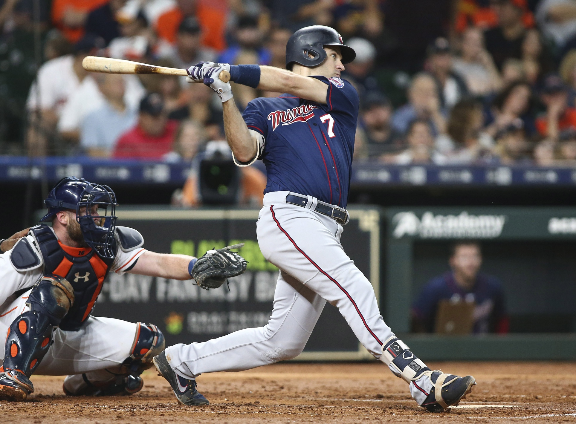 Sep 3, 2018; Houston, TX, USA; Minnesota Twins first baseman Joe Mauer (7) hits a single during the third inning against the Houston Astros at Minute Maid Park. Mandatory Credit: Troy Taormina-USA TODAY Sports